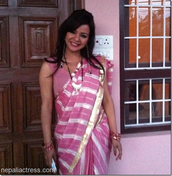 Poojana Stri in Chihan -saree