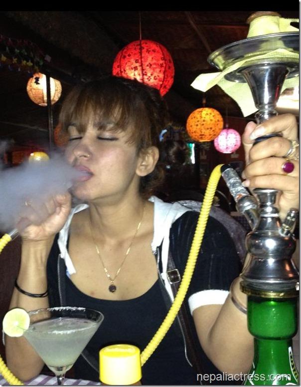 Jharana thapa smoking hukka (1)