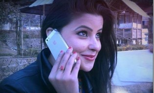 sushma-adhikari-talks-in-iphone_thumb.jpg