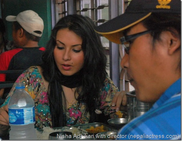 nisha adhikari and director Himgyap Tasi eating