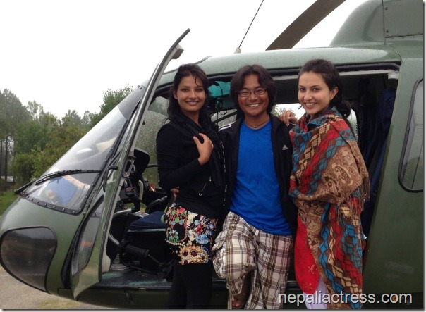 nisha adhikari sumina ghimire and himgyap tasi at the door of army helicoptor