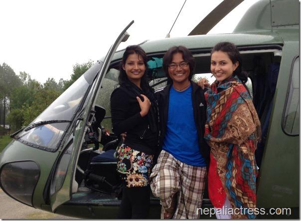 nisha adhikari sumina ghimire and himgyap tasi at the door of army helicoptor
