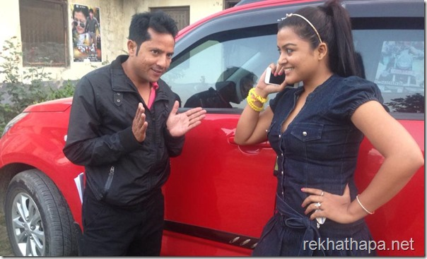 Rekha Thapa and Shyam Bhattarai talk beside Rekhas new car