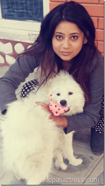 keki adhikari with dog