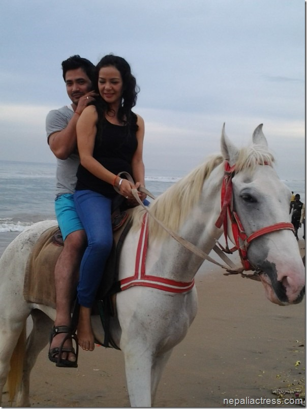 shivam and poojana shrestha on a horse