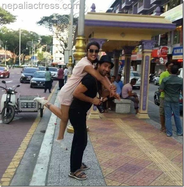 Jiwan Luitel carrying Priyanka karki in Malaysia