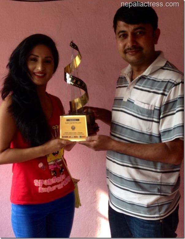 Yadhav bhattarai hands over the award trophy (3)