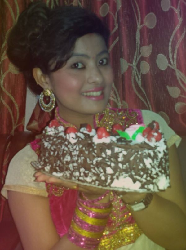 rajani kc with birthday cake