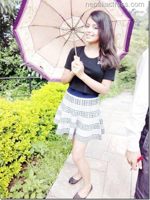 neeta dhungana with umbrella