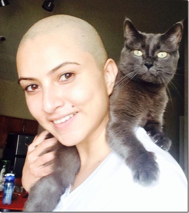 nisha adhikari with cat bald