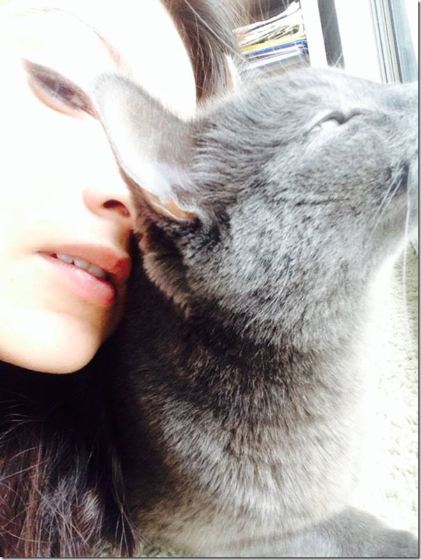 nisha with cat and hair