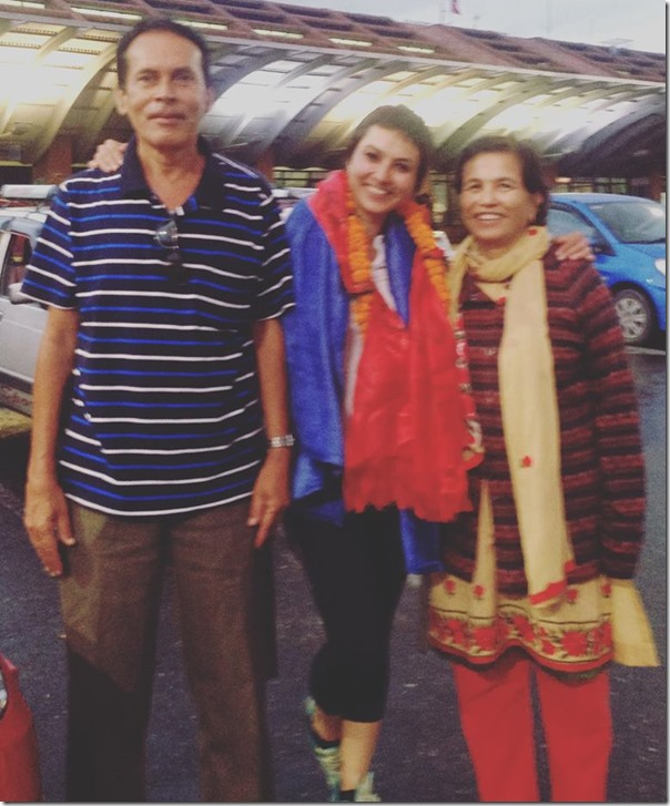 nisha adhikari with her mother and father