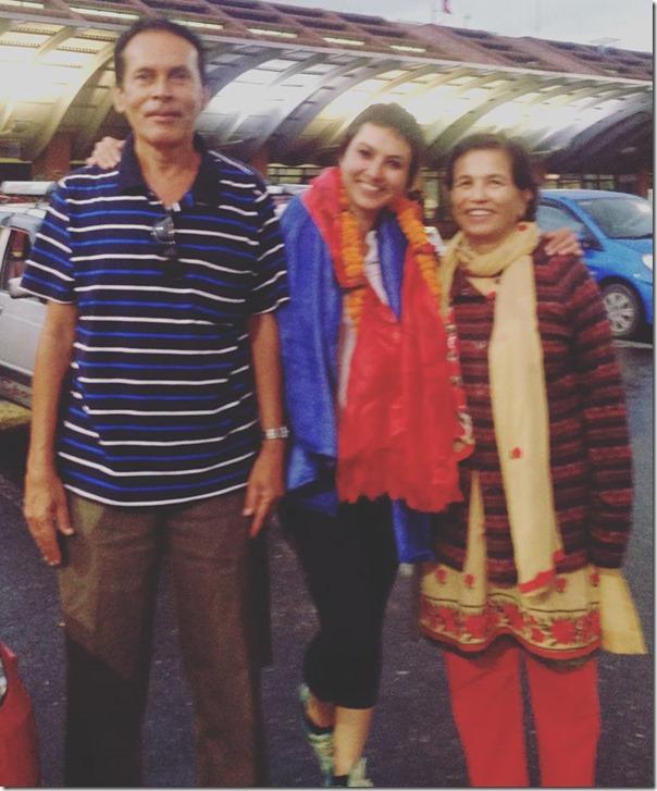 nisha adhikari with her mother and father