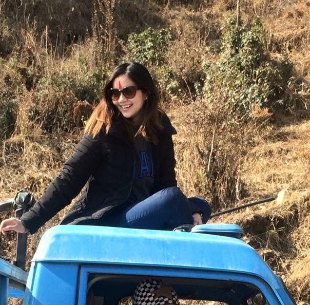 miruna-magar-rides-on-top-of-a-vehicle