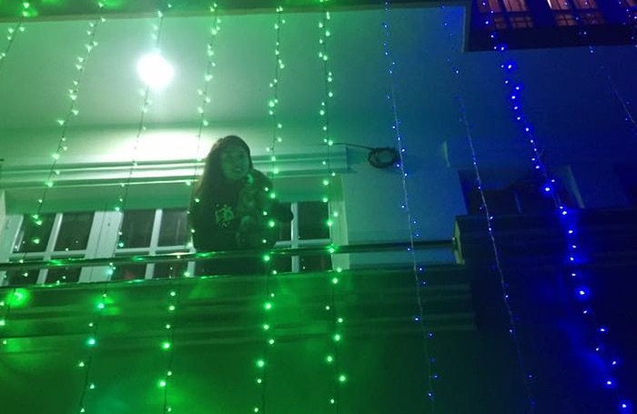 pooja-sharma-siting-on-the-varandah-of-her-house-covered-in-colourful-lights